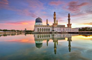Colorful sunrise over floating mosque in Kota Kinabalu, Sabah Borneo, Malaysia.
